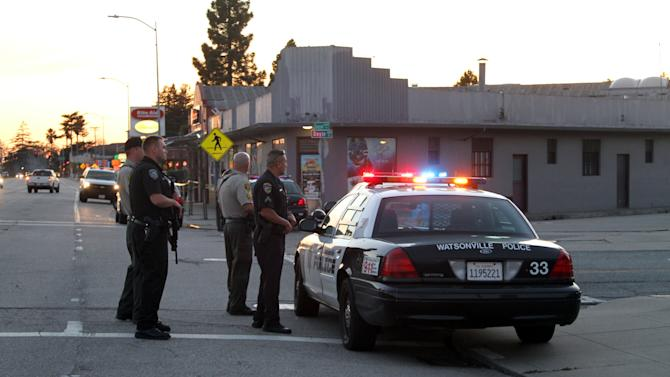 Police secure the scene near N. Branciforte Avenue and Doyle Street in Santa Cruz, Calif., where two Santa Cruz Police Detectives were shot and killed Tuesday, Feb. 26, 2013. The officers were killed while investigating a sexual assault, and a suspect was also fatally shot, authorities said. (AP Photo/Thomas Mendoza)