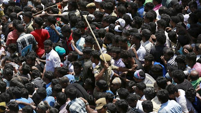 Police try to control crowd as they attend the funeral ceremony of former President A. P. J. Abdul Kalam in Rameswaram