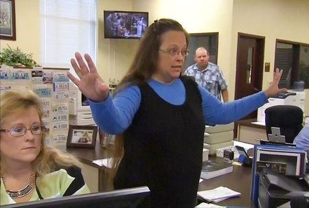 Rowan County Clerk Kim Davis gestures as she refuses to issue marriage licenses to a same-sex couple in Morehead