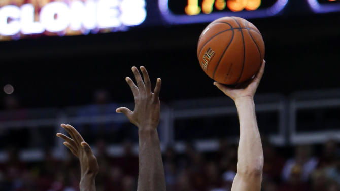 Iowa State forward Georges Niang (31) shoots over Maryland forward Jonathan Graham (25) in the first half of an NCAA college baseball tournament Tuesday, Nov. 25, 2014, in Kansas City, Mo. (AP Photo/Ed Zurga)