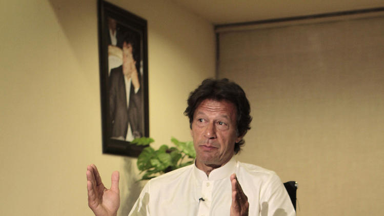"""In this Friday, March 22, 2013, photo, Pakistani cricket legend-turned politician Imran Khan speaks during an interview with The Associated Press in Lahore, Pakistan. Khan rallied around 100,000 flag-waving supporters in the eastern city of Lahore on Saturday ahead of a historic national election later this spring.  """"This is going to swing the election,"""" Khan told The Associated Press in an interview before the rally. """"The youth is standing with us and change.""""  (AP Photo/K.M. Chaudary)"""