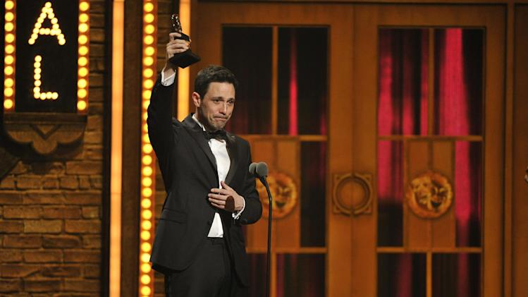 "Steve Kazee accepts the Best Performance by an Actor in a Leading Role award for his performance in ""Once"" at the 66th Annual Tony Awards on Sunday June 10, 2012, in New York. (Photo by Charles Sykes /Invision/AP)"