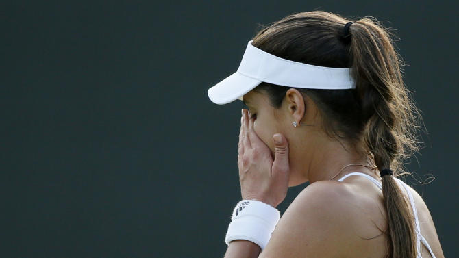 Ana Ivanovic of Serbia reacts during her match against Bethanie Mattek-Sands of the U.S.A. at the Wimbledon Tennis Championships in London
