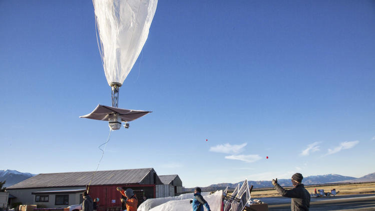 In this June 10, 2013 photo released by Google, a Google team releases a balloon in Tekapo, New Zealand. Google is testing the balloons which sail in the stratosphere and beam the Internet to Earth. (AP Photo/Google, Andrea Dunlap) EDITORIAL USE ONLY