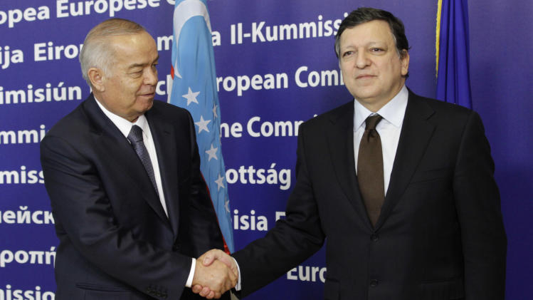 Uzbekistan President Islom Karimov, left,  looks at European Commission President Jose Manuel Barroso, as he is welcomed at the European Commission headquarters in Brussels, Monday, Jan. 24, 2011. (AP Photo/Yves Logghe)