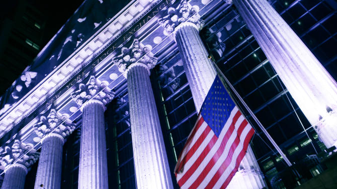 In this Wednesday, Oct. 8, 2014, photo, an American flag flies in front of the New York Stock Exchange. Global stock markets rose Wednesday, Oct. 7, 2015, taking in stride the IMF's lower global growth forecast, as oil prices extended a rebound. (AP Photo/Mark Lennihan)