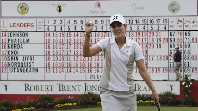 Jennifer Johnson acknowledges the crowd after completing play in the final round of the Mobile Bay LPGA Classic golf tournament at the Robert Trent Jones Golf Trail at Magnolia Grove in Mobile, Ala. Sunday, May 19, 2013. (AP Photo/Dave Martin)