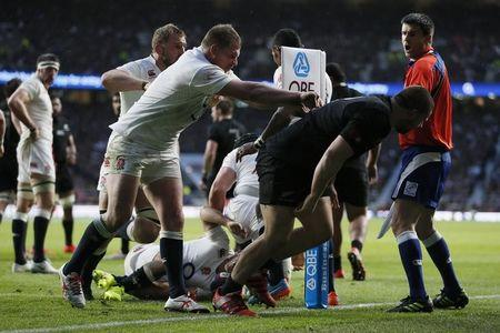 England's Hartley pushes New Zealand's Kaino during their international rugby union match at Twickenham in London