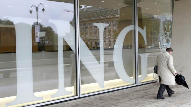 A pedestrian walks past the logo of ING bank by the entrance of the group's main office in Brussels