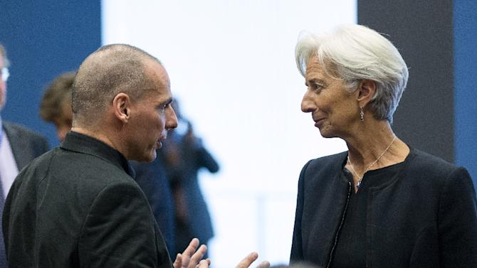Greek Finance Minister Yanis Varoufakis (L) speaks with International Monetary Fund Managing Director Christine Lagarde prior to a eurozone finance ministers meeting at the European Union Council headquarters in Luxembourg on June 18, 2015