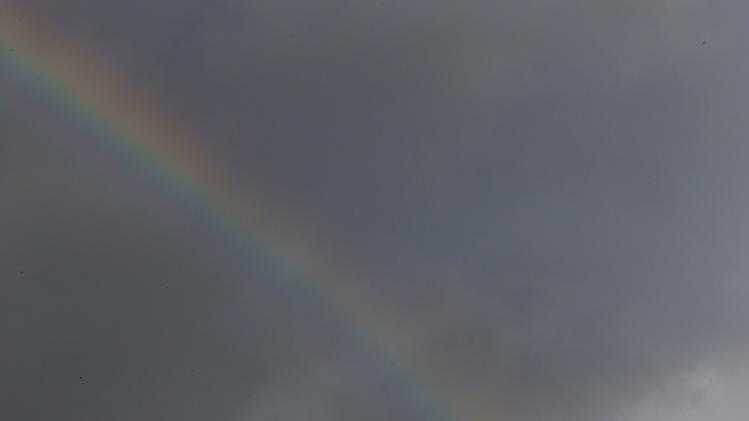 A rainbow appears over a weathervane in Loughborough