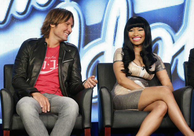 CORRECTS DAY AND DATE - Keith Urban and Nicki Minaj from &quot;American Idol&quot; attend the Fox Winter TCA Tour at the Langham Huntington Hotel on Tuesday, Jan. 8, 2013, in Pasadena, Calif. (Photo by Todd Williamson/Invision/AP)