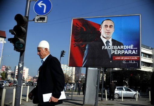 <p>A Kosovo Albanian walks past a billboard featuring the portrait of Kosovo's ex-prime minister Ramush Haradinaj in Pristina on November 27. The UN's Yugoslav war crimes court will on Thursday hand down judgement for Haradinaj and two comrades in arms who were re-tried because of witness intimidation.</p>