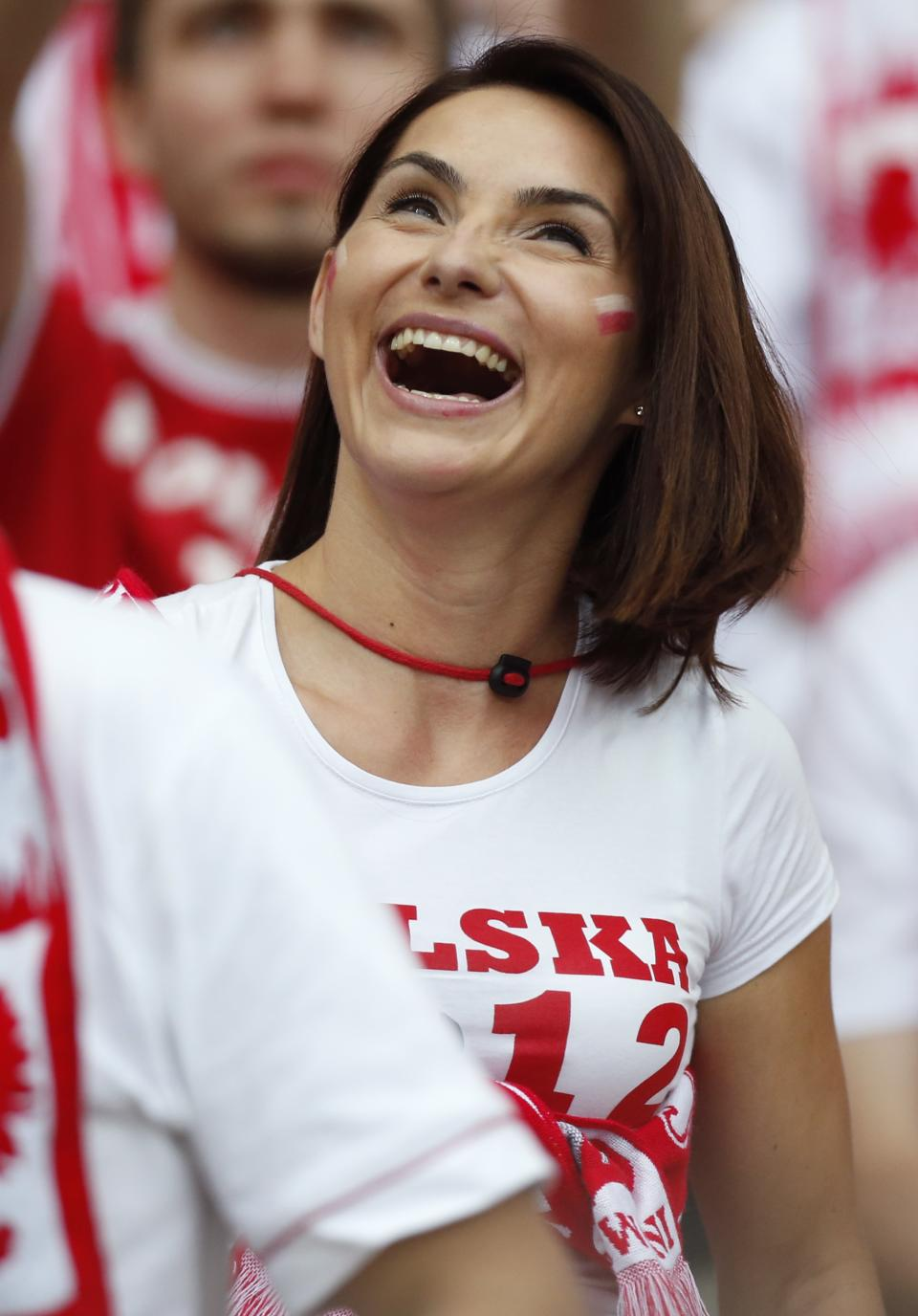A Poland supporer smiles prior to the Euro 2012 soccer championship Group A match between Poland and Russia in Warsaw, Poland, Tuesday, June 12, 2012. (AP Photo/Matt Dunham)