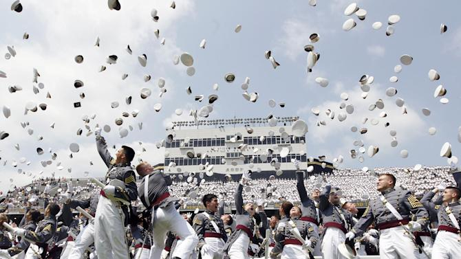 Cadets throw their hats in the air to conclude a graduation and commissioning ceremony at the U.S. Military Academy in West Point, N.Y., Saturday, May 26, 2012. (AP Photo/Mike Groll)