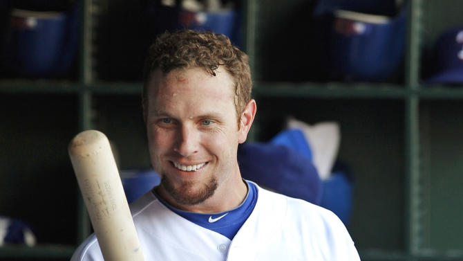FILE - In this June 3, 2012, file photo, Texas Rangers' Josh Hamilton stands in the dugout during the first inning of a baseball game against the Oakland Athletics in Arlington, Texas. Rangers general manager Jon Daniels said Thursday, Dec. 13, 2012, that Hamilton has agreed to a contract with the Los Angeles Angels. (AP Photo/Tim Sharp, File)