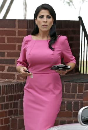 """FILE - In this Nov 13, 2012 file photo Jill Kelley leaves her home in Tampa, Fla. The Tampa socialite at the center of a scandal involving Gen. David Petraeus has hired a top Washington attorney and seems to be trying to change the narrative about her friendship with the general, her past and her role as an """"honorary consul"""" to the country of South Korea. On Tuesday, Nov. 27, 2012, Kelley's attorney Abbe Lowell released emails, telephone recordings and other material that he and Kelley say proves she never tried to exploit her friendship with Petraeus. (AP Photo/Chris O'Meara, File)"""