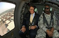 US Secretary of Defense Leon Panetta (L) and Commanding General of US Forces in Iraq, Lt. Gen. Lloyd Austin fly in a Blackhawk helicopter over Baghdad. American forces are pursuing Iran-backed insurgents in Iraq, Panetta said in Baghdad on Monday as US deaths spike nearly a year after US troops formally ended combat operations
