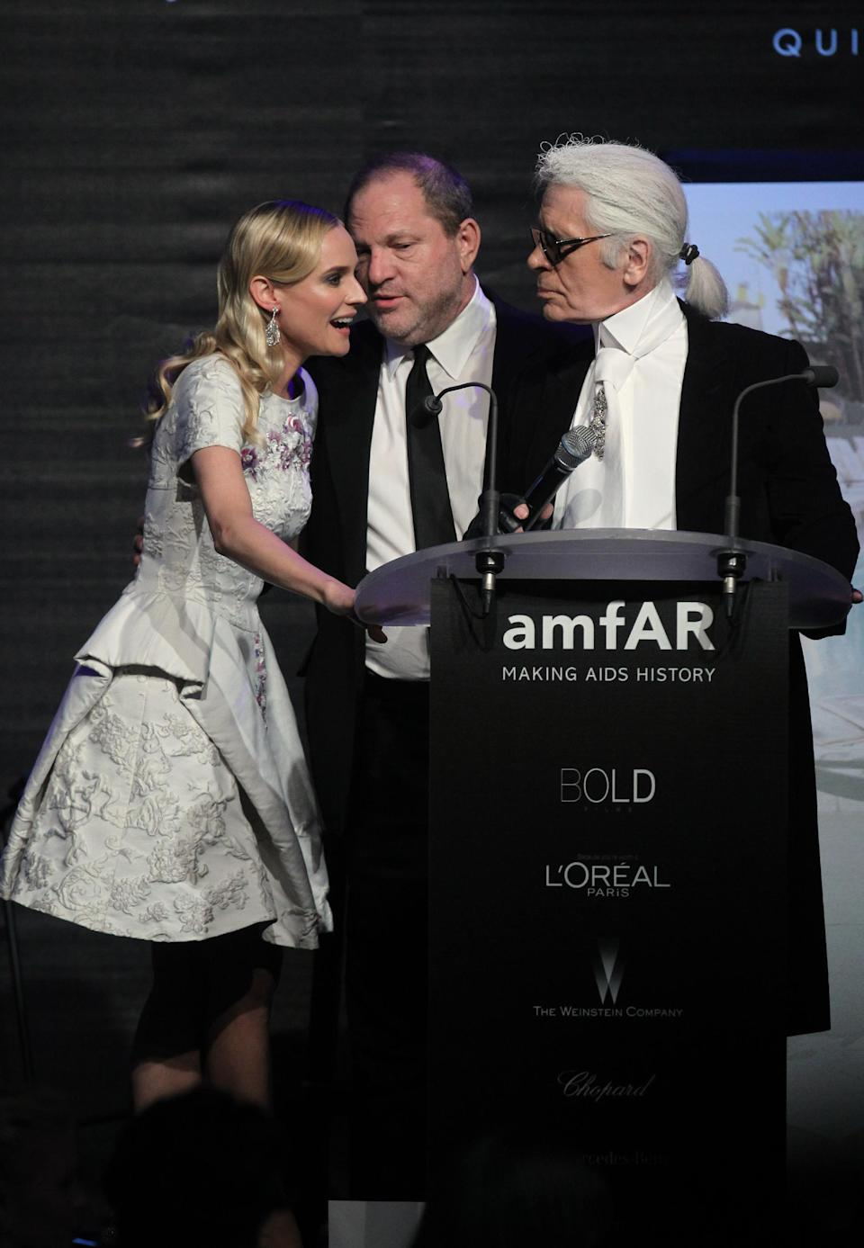 Diane Kruger, Harvey Weinstein and Karl Lagerfeld during the auction for the amfAR Cinema Against AIDS benefit during the 65th Cannes film festival, in Cap d'Antibes, southern France, Thursday, May 24, 2012. (AP Photo/Joel Ryan)