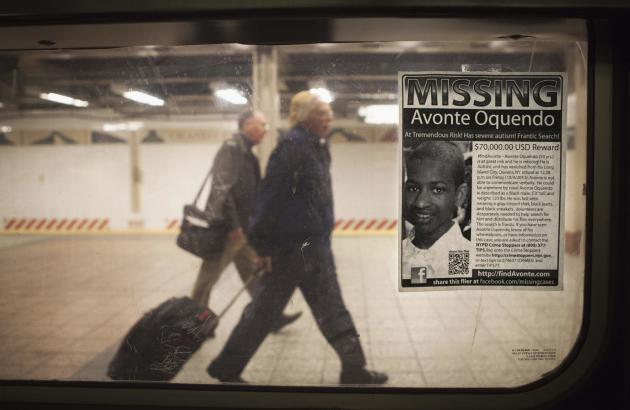 A missing poster for Avonte Oquendo, a 14-year-old autistic boy who has been missing for 3 weeks since walking out of his school, is posted on a subway window in the Times Square station of New York