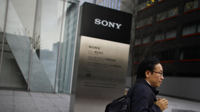 "In this Thursday, Feb. 7, 2013 photo, a man walks outside Sony's headquarters in Tokyo.  As the yen weakens, famous Japanese exporters are getting a boost but the favorable exchange rate also carries risks by insulating some companies from pressure to overhaul their businesses. Sony Corp., which has floundered for several years as its mainstay TV business was battered by competition and falling prices, says it has striven to become ""dollar neutral"" - business speak for making its profits less dependent on the fluctuating exchange rate between the dollar and the yen. (AP Photo/Junji Kurokawa)"