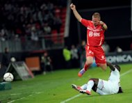 Valenciennes&#39; defender Rudy Mater (Top) jumps to avoid Bordeaux&#39;s forward Cheick Diabate during their French L1 football match at the Stade du Hainaut in Valenciennes, northern France. The match ended in a goalless draw