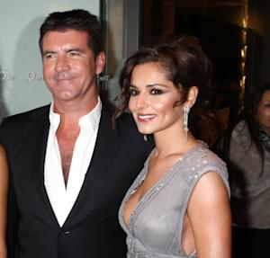 Simon Cowell and Cheryl Cole, 2010 -- Getty Images