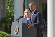 President Barack Obama, joined by Secretary of State Hillary Clinton, condemned the &quot;outrageous&quot; attack which killed four Americans including the US ambassador in Libya but vowed it would not break America&#39;s bond with the newly liberated nation