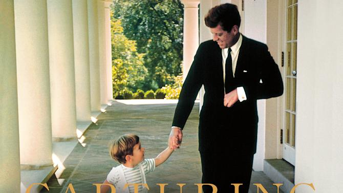 """This cover image released by Thomas Dunne Books shows """"Capturing Camelot: Stanley Tretick's Iconic Images of the Kennedys,"""" by Kitty Kelley. The book features intimate images of John F. Kennedy by Kelley's close friend, photojournalist Stanley Tretick, who is known for his incredible access to the president and his family. (AP Photo/ Thomas Dunne Books)"""