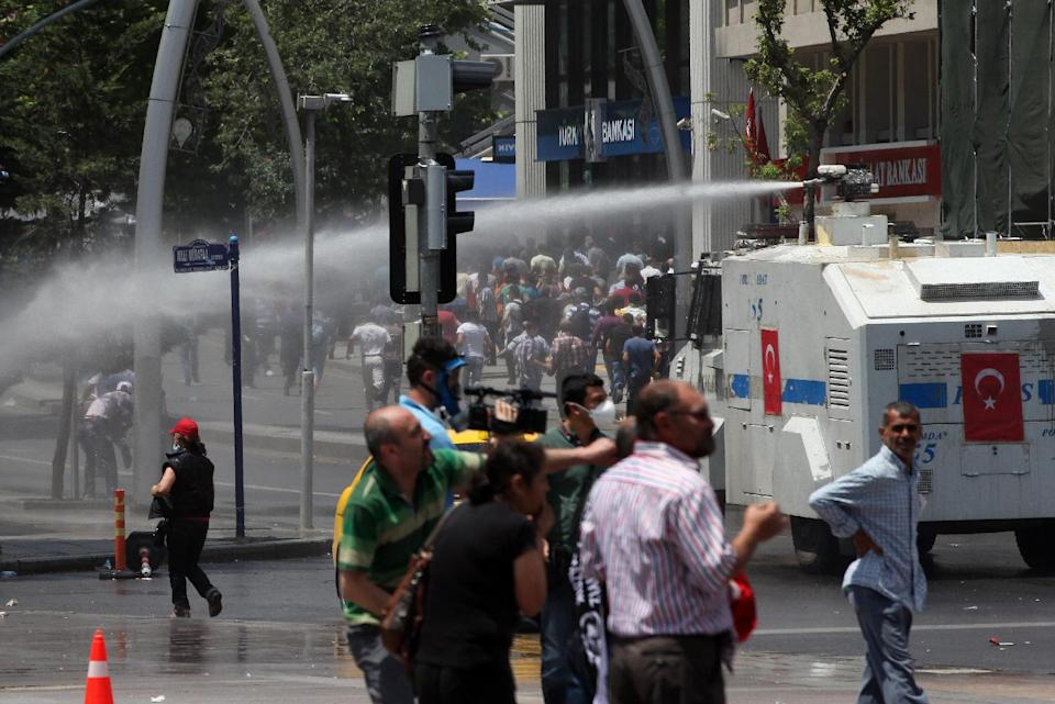 Turkish riot police spray water cannon at demonstrators who remained defiant after authorities evicted activists from an Istanbul park, making clear they are taking a hardline against attempts to rekindle protests that have shaken the country, in city's main Kizilay Square in Ankara, Turkey, Sunday, June 16, 2013. (AP Photo/Burhan Ozbilici)