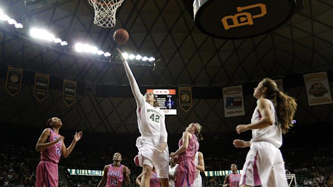 Baylor 's Brittney Griner (42) goes up for a finger roll layup as TCU's Natalie Ventress (24), Zahna Medley (14) and Kamy Cole, center right, look on in the second half of an NCAA college basketball game Saturday, Feb. 16, 2013, in Waco, Texas. Griner had a game-high 22-points in the 78-45 Baylor win. (AP Photo/Tony Gutierrez)