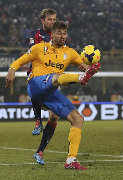 Juventus' Fernando Llorente, controls the ball ahead of Bologna defender Mikael Antonsson, of Sweden, during the Serie A soccer match between Bologna and Juventus at the Dall' Ara stadium in B