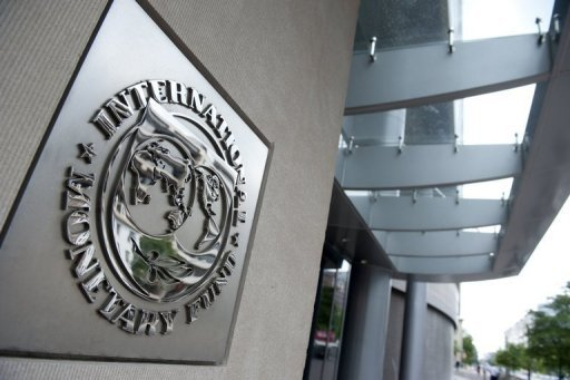 "<p>The logo of the International Monetary Fund (IMF) at the organization's headquarters in Washington, DC. After searching for months for cash, the IMF looks able to firm up a huge emergency ""firewall"" fund for crisis prevention after China said Sunday that big emerging economies would chip in.</p>"