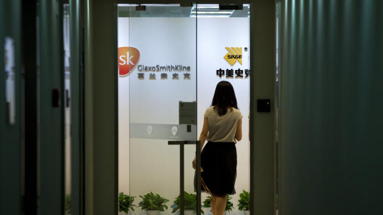China names 4 GSK managers in drug bribery probe