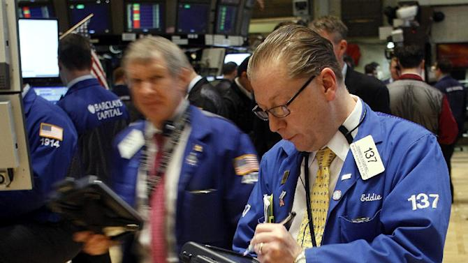 In this Feb. 13, 2012 photo, trader Edward H. Radzienwicz works the floor of the New York Stock Exchange. Another mass downgrade of the creditworthiness of European countries had little market impact Tuesday, Feb. 14, as investors continued to predict that Greece would soon get its hands on vital bailout cash to avoid a ruinous bankruptcy. (AP Photo/David Karp)