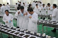 Judges are seen inspecting and tasting tea during a contest in Nantou, central Taiwan. The island's tea industry peaked in 1973 when it produced 28,000 tonnes of tea leaves, with 23,000 tonnes being exported, but since then the sector has been gradually losing its competitiveness due to labour shortages, rising labour costs and the appreciation of the local currency