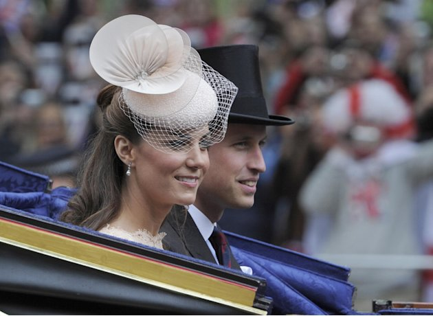 Britain's Prince William and Kate Duchess of Cambridge pass along The Mall as part of a four-day Diamond Jubilee celebration to mark the 60th anniversary of  Queen Elizabeth's  accession to the throne