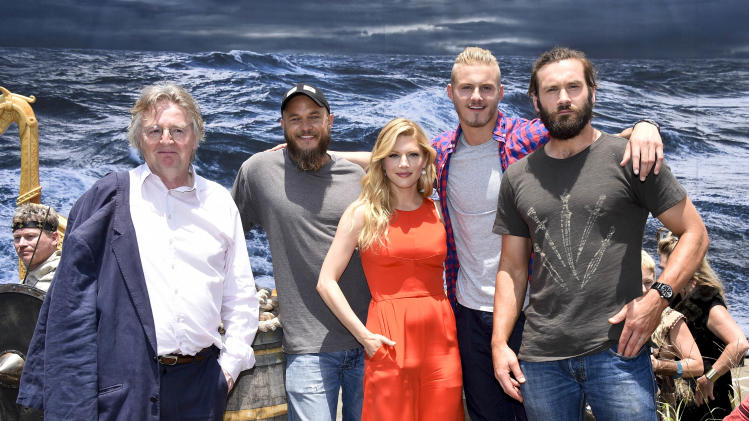 "IMAGE DISTRIBUTED FOR THE HISTORY CHANNEL - HISTORY's VIKINGS series creator and writer Michael Hirst, left, poses with VIKINGS stars Travis Fimmel, Katheryn Winnick, Alexander Ludwig, and Clive Standen at the ""On the Set with VIKINGS"" interactive experience outside the 2014 Comic-Con International Convention on Friday, July 25, 2014 in San Diego. Throughout the weekend, fans got a behind-the-scenes look at VIKINGS and a starring role in their own custom video. (Photo by Denis Poroy/Invision/AP)"