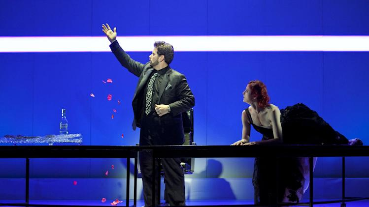 In this May 10, 2012 photo provided by the New York City Opera, Nicholas Pallesen is in the role of Pluto, with Catherine Miller as Thanatos at a dress rehearsal of the New York City Opera's Orpheus, at El Museo del Barrio in New York. (AP Photo/NYC Opera,  Pavel Antonov)