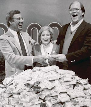 "File-This Jan. 16, 1986. file photo shows host Jim Lange, left, congratulating Connie and Steve Rutenbar of Mission Viejo, Calif., after they won $1 million on the TV show "" The $1,000,000 Chance of a Lifetime"". Lange, the first host of the popular game show ""The Dating Game,"" has died at his home in Mill Valley, Calif. He was 81. He died Tuesday morning after suffering a heart attack, his wife Nancy told The Associated Press Wednesday, Feb. 26, 2014. (AP Photo/File)"