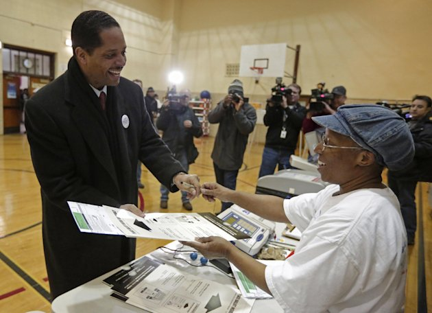 Chicago Alderman Anthony Beale, a Democrat, speaks with election judge Nancy Karen as he casts his vote in Chicago, Tuesday, Feb. 26, 2013, in the special primary election to replace former U.S. Rep. Jesse Jackson in Illinois' 2nd Congressional District. Beale is one of three front-runners in the primary. The others include former state Rep. Robin Kelly and former U.S. Rep. Debbie Halvorson. They were among 14 Democrats and four Republicans in the special primary, but the Democratic winner is expected to sail through the April 9 general election because of the heavily Democratic region. (AP Photo/M. Spencer Green)