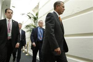 Boehner arrives with his security detail for a House Republican caucus meeting at the U.S. Capitol in Washington