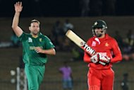 South African cricketer Jacques Kallis (L) celebrates after he dismissed Zimbabwe cricketer Graeme Cremer during their ICC Twenty20 Cricket World Cup match at The Mahinda Rajapaksa International Cricket Stadium in Hambantota. Jacques Kallis recorded the best Twenty20 figures for his country to inspire South Africa to a convincing 10-wicket win over Zimbabwe