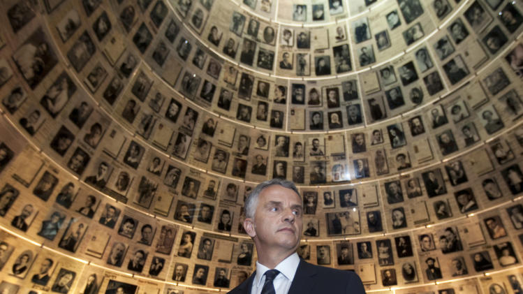 Swiss Foreign Minister Didier Burkhalter visits the Hall of Names at the Yad Vashem Holocaust memorial in Jerusalem, Thursday, May 2, 2013. Burkhalter is on an official visit to the region. (AP Photo/Sebastian Scheiner)