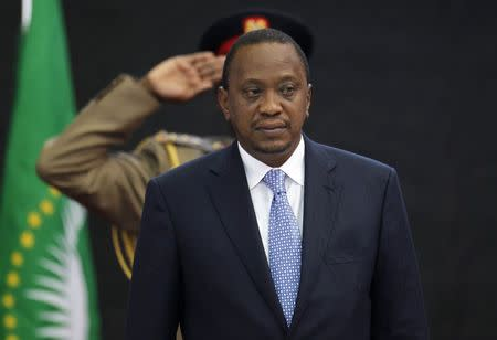 Kenya's President Kenyatta stands for Kenya's national anthem before the Africa Union Peace and Security Council Summit on Terrorism at the Kenyatta International Convention Centre in Nairobi