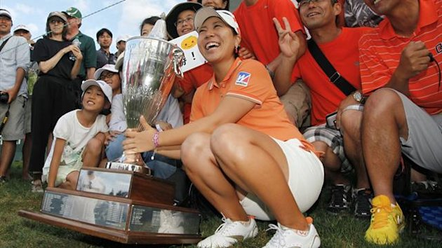 Mika Miyazato of Japan celebrates win to beat Brittany Lincicome of the U.S. and Park In-bee of South Korea with fans at the LPGA Safeway Classic in North Plains, Oregon (Reuters)