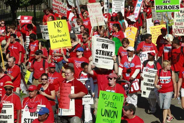 Striking Chicago school teachers march after a rally Saturday, Sept. 15, 2012 in Chicago. Thousands of striking Chicago public school teachers and their allies packed a city park Saturday in a boister