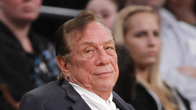 FILE - In this Dec. 19, 2011 file photo, Los Angeles Clippers owner Donald Sterling watches the Clippers play the Los Angeles Lakers during an NBA preseason basketball game in Los Angeles. The future of the Clippers is closer to decision as testimony resumes Monday, July 21, 2014, in a probate trial over whether a deal negotiated by Donald Sterling's estranged wife to sell the team for $2 billion is authorized under a Sterling family trust. (AP Photo/Danny Moloshok, File)