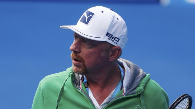 Coach Boris Becker watches Novak Djokovic of Serbia during a practice session at Margaret Court Arena in Melbourne