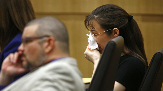 """Jodi Arias cries as Steven Alexander, brother of murder victim Travis Alexander, reads his """"victim impact statement"""" to the jury on Thursday, May 16, 2013, during the penalty phase of the Jodi Arias trial at Maricopa County Superior Court in Phoenix.  Jodi Arias was convicted of first-degree murder in the stabbing and shooting to death of Travis Alexander, 30, in his suburban Phoenix home in June 2008. (AP Photo/The Arizona Republic, Rob Schumacher, Pool)"""